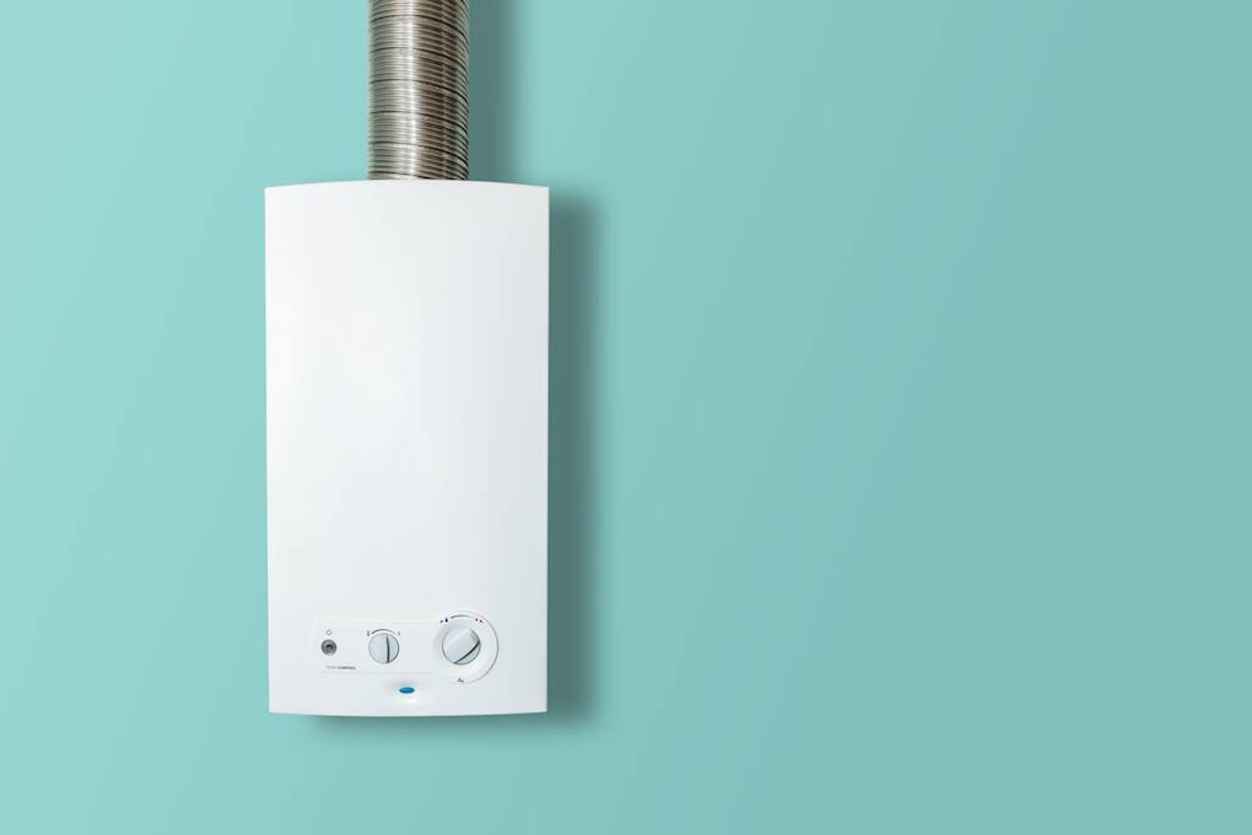 How to diagnose boiler problems: white boiler on a blue wall