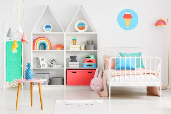 childs play room with orange wall