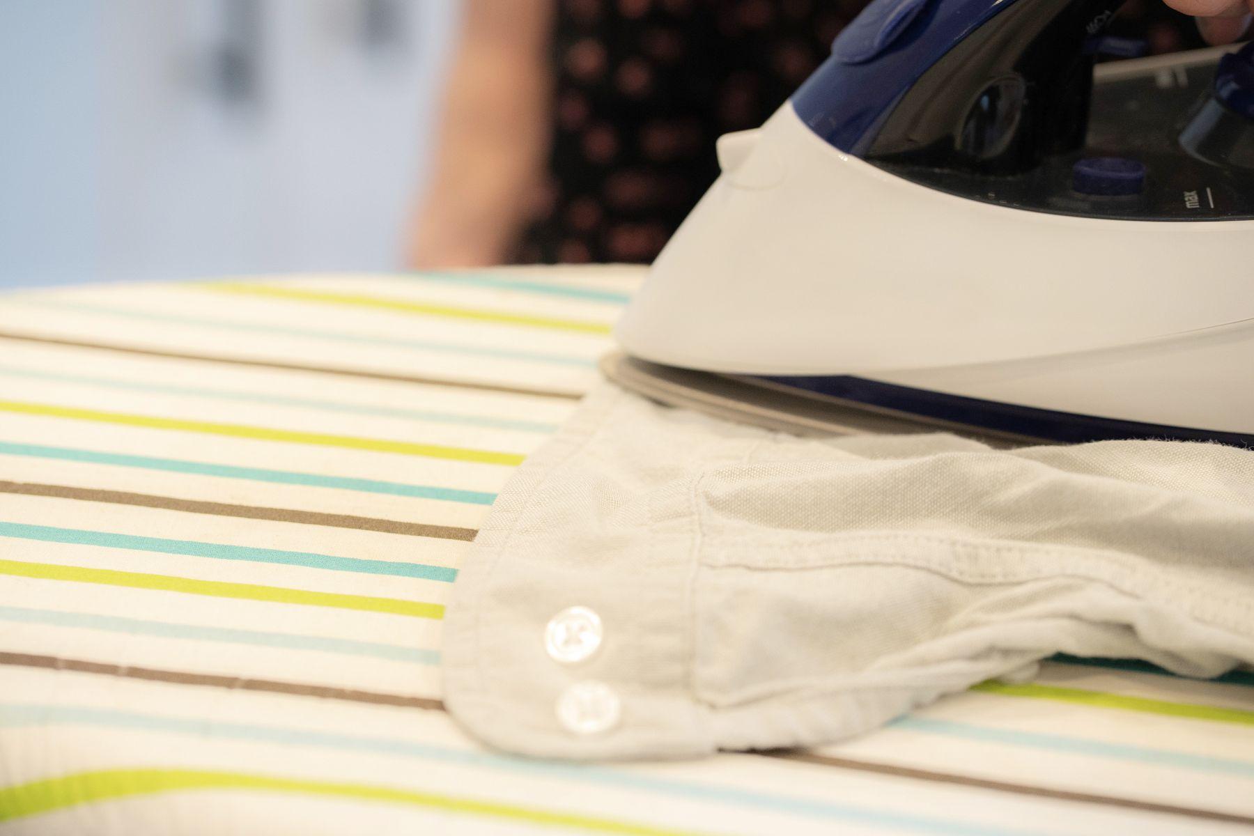 Ironing the cuffs of a shirt