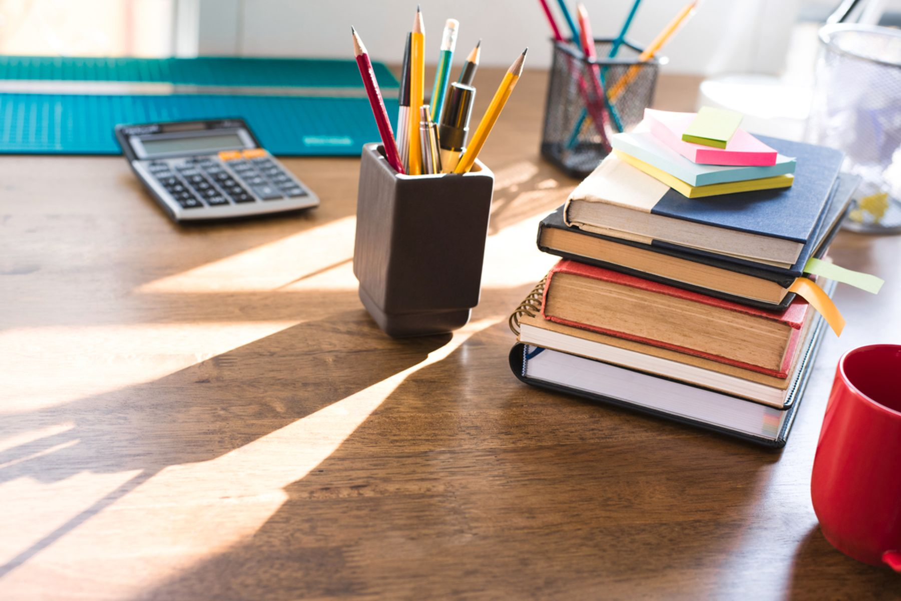 Image of a desk with books and office supplies