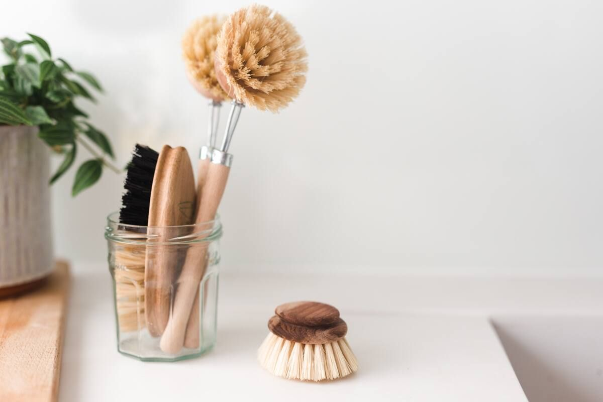 cleaning brushes in a glass pot