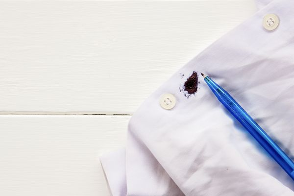A white shirt with an ink stain from a pen