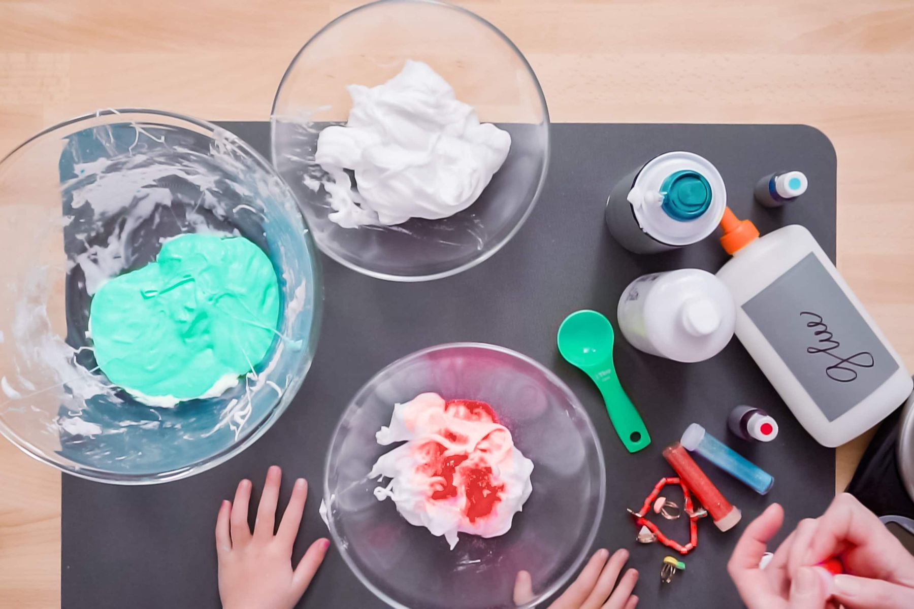 Bright slime making with childrens hands