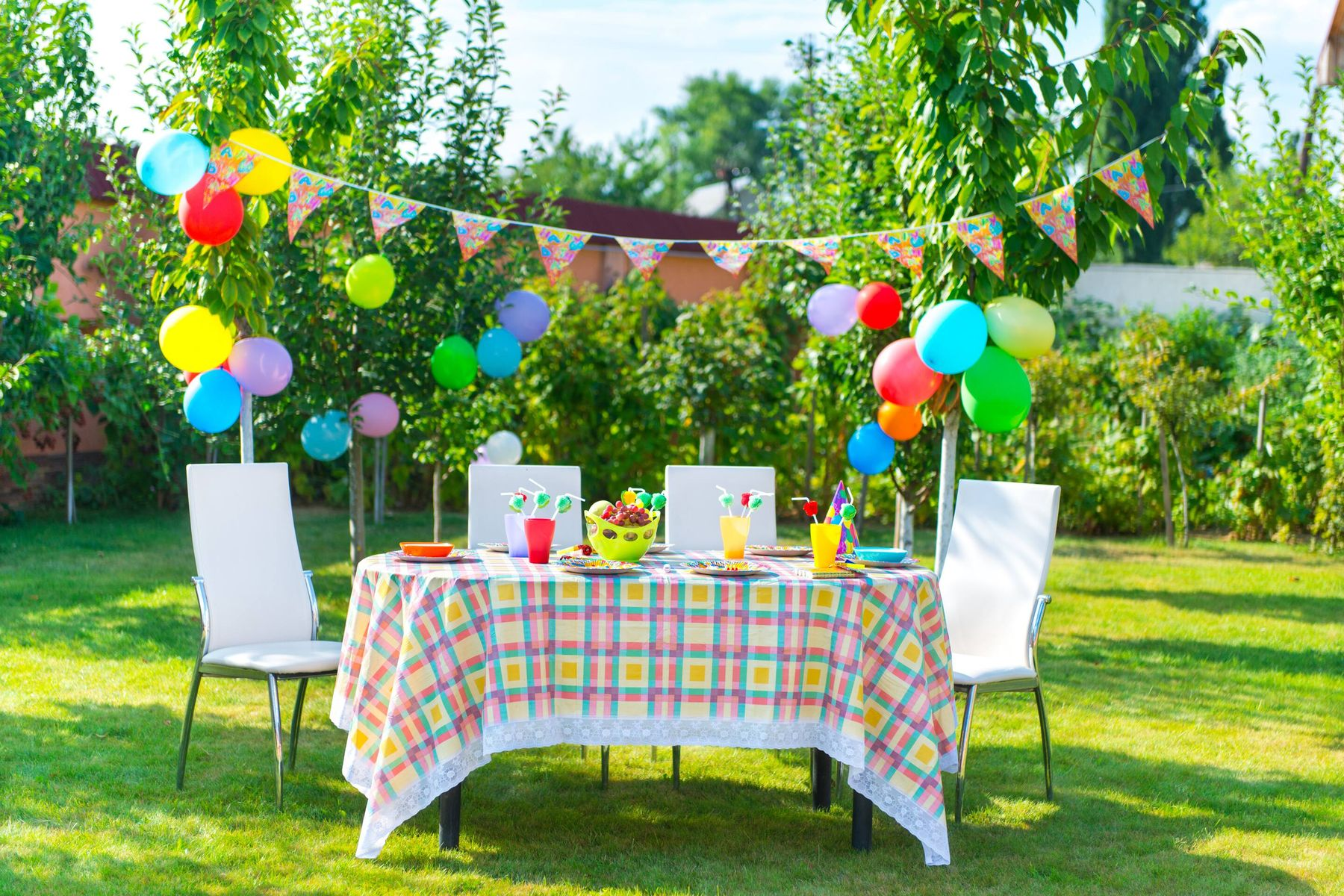 child's party with balloons in the garden