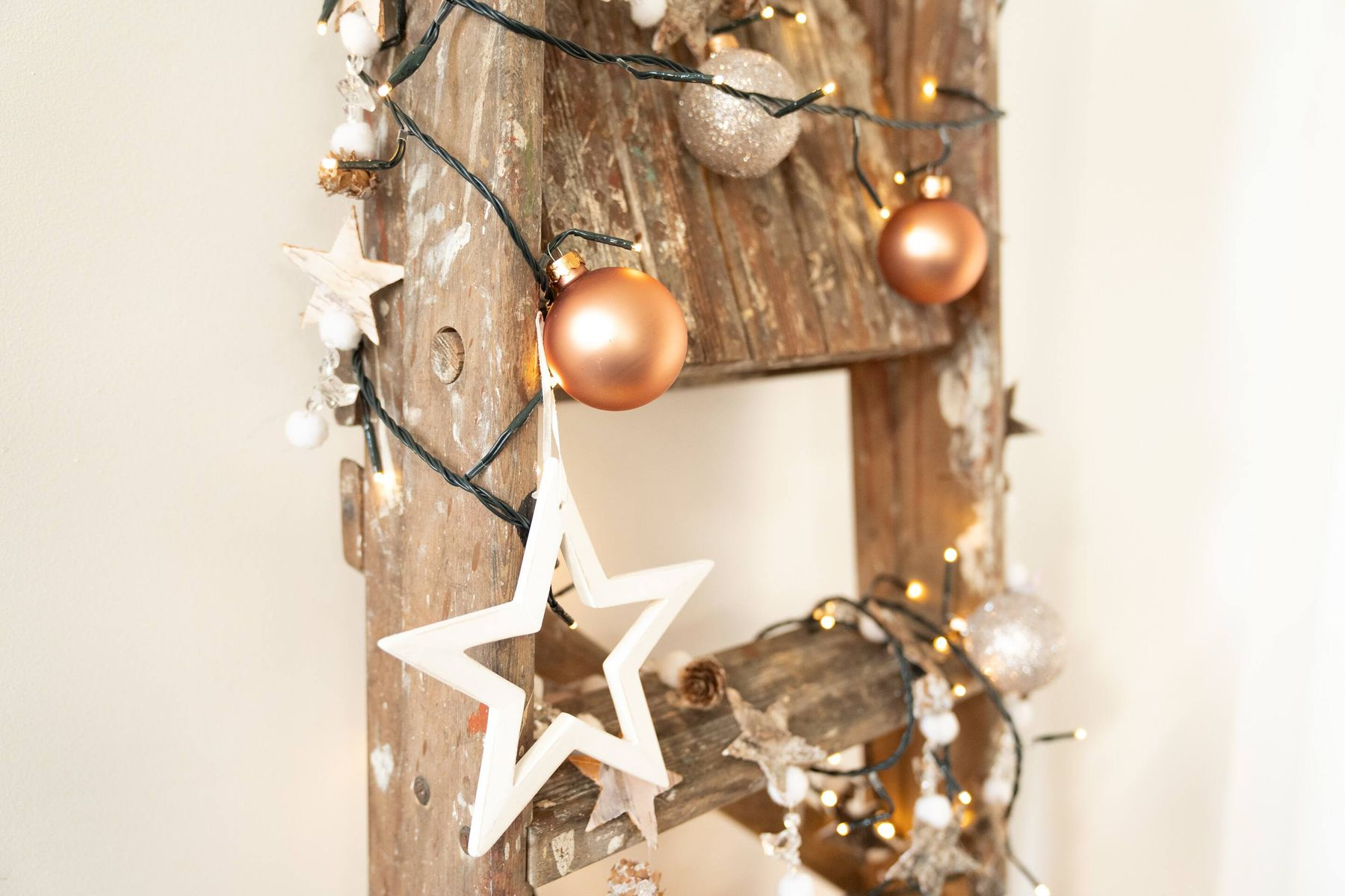 Christmas tree made with wooden ladder and ornaments