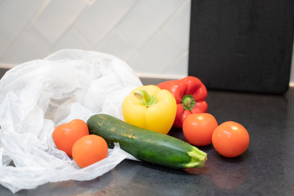Assorted vegetables beside a plastic bag