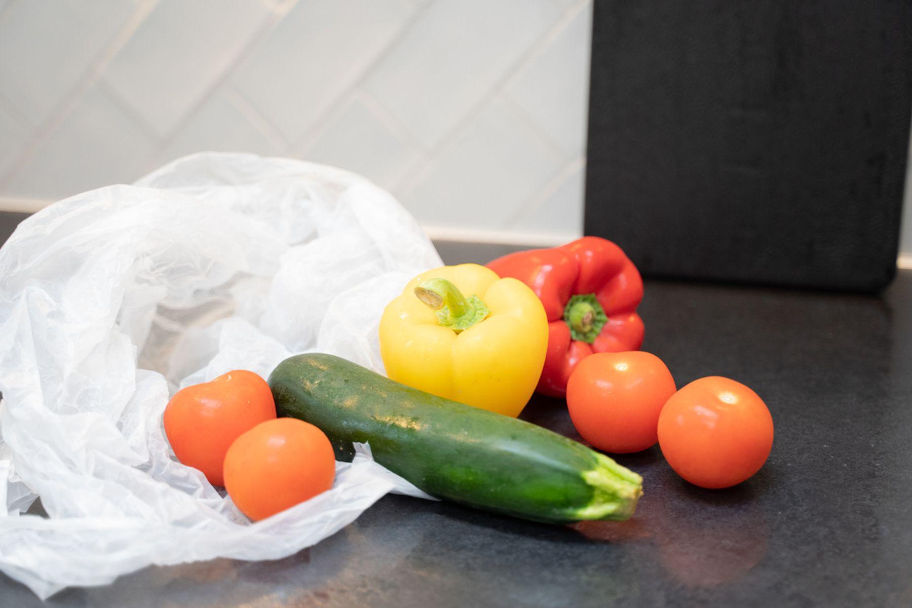 Assorted vegetables beside a plastic bag