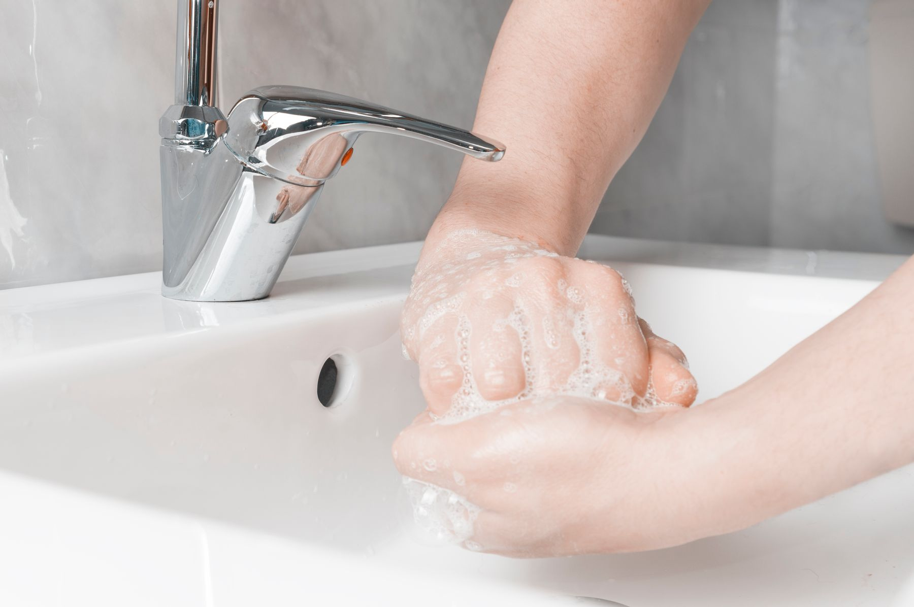 Step 5: person washing finger nails