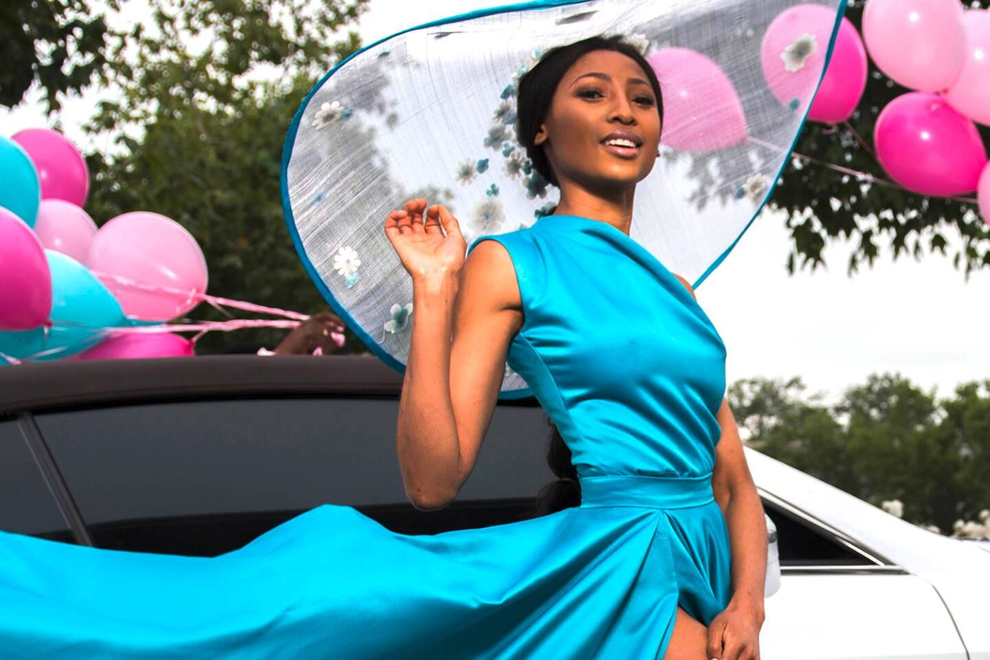 Skip lady in blue dress with pink & blue balloons
