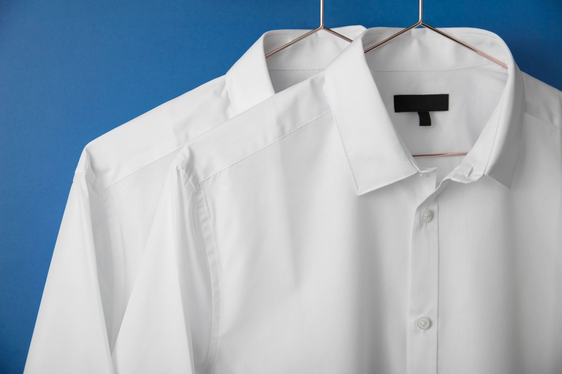 white shirts on hangers