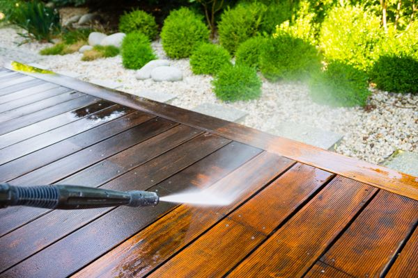 decking being cleaned with pressure washer