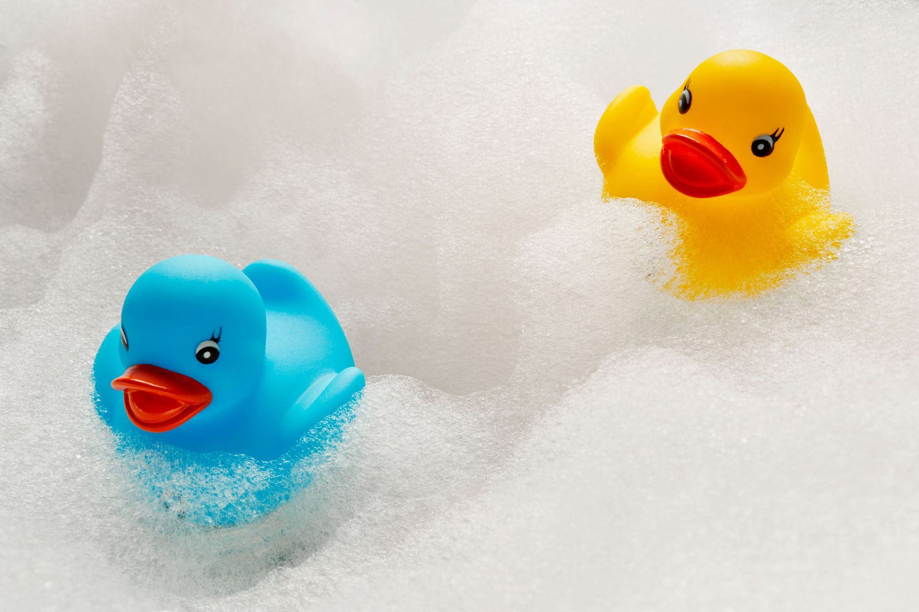 clean baby toy rubber ducks in a bath