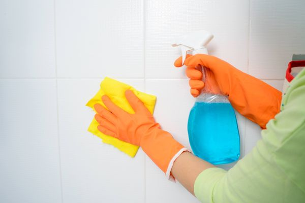 Hand cleaning tiles with cleaning product