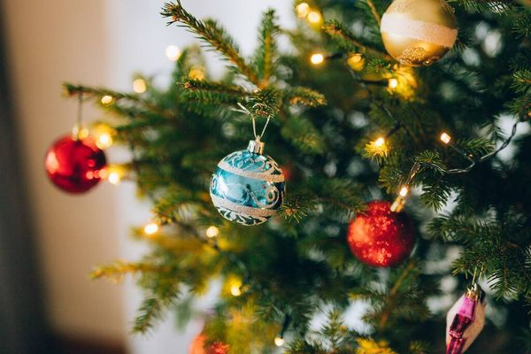 Looking after a real Christmas tree: close up with baubles