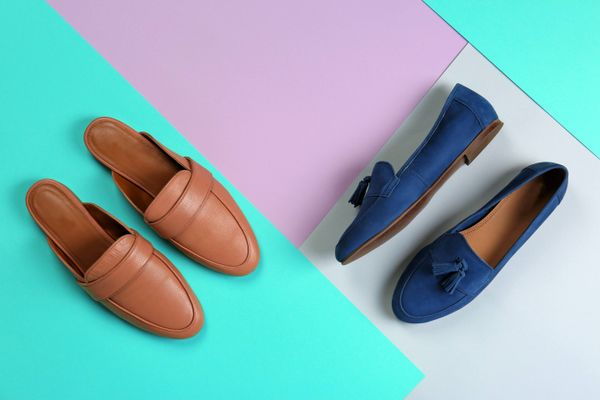 brown and blue shoes on a colourful floor