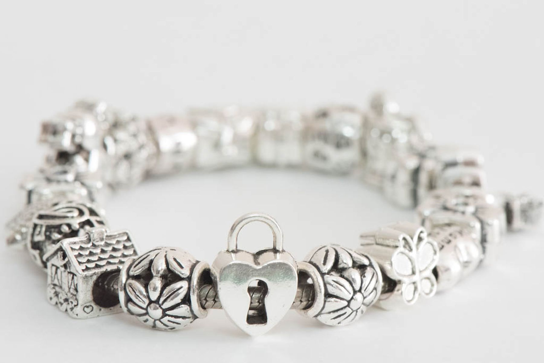 simple shot of a silver pandora bracelet with charms