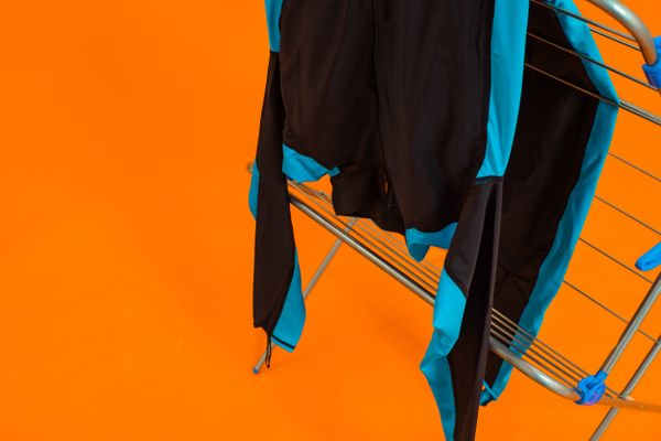 wetsuit-hanging-from-a-clothes-horse