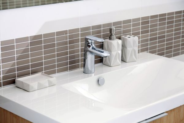 white bathroom sink with silver mixer tap