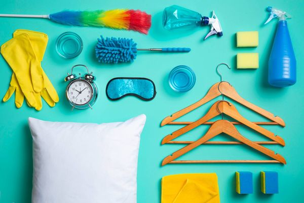 A collection of household cleaning equipment against a blue background