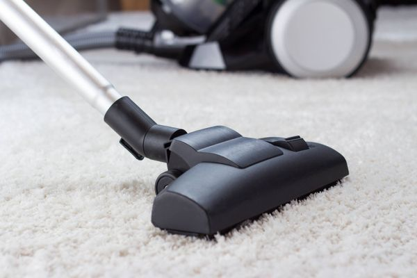 vacuum on carpet helping get rid of dust and odours