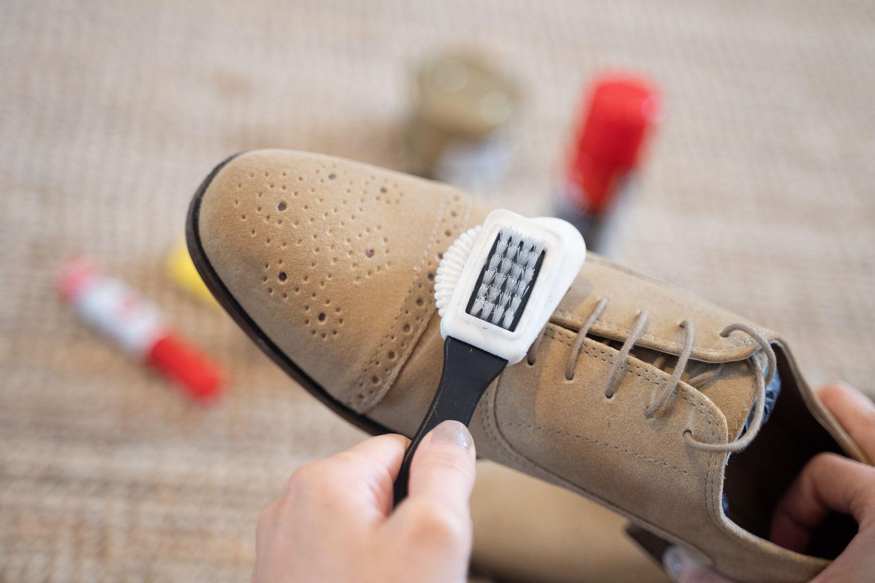 Brushing nubuck shoes with a nubuck brush