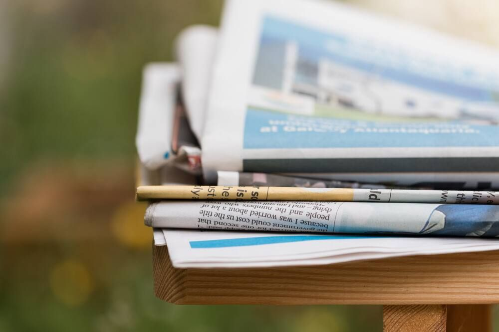 Stack of newspapers outdoors