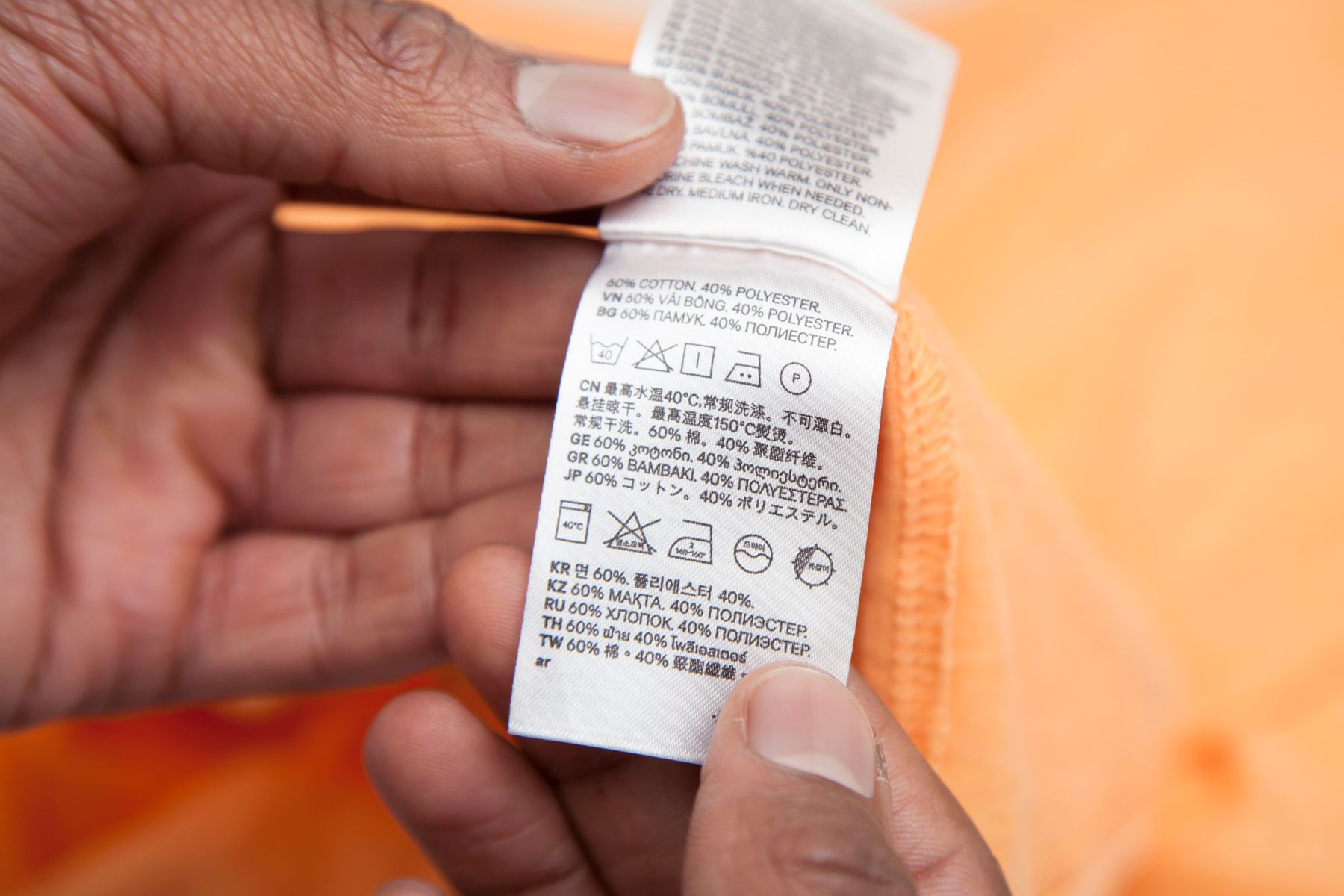 Looking at washing symbols on the care label in clothes