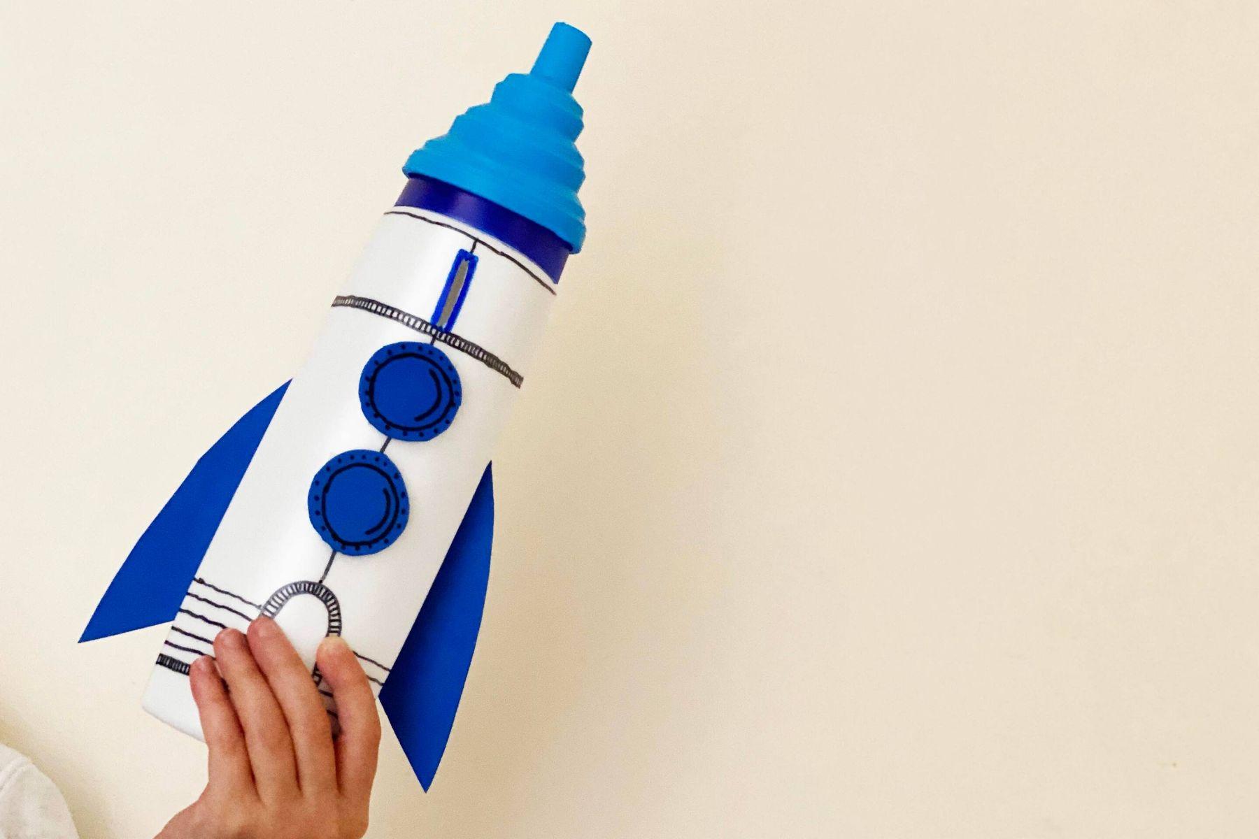 A plastic bottle rocket piggy bank