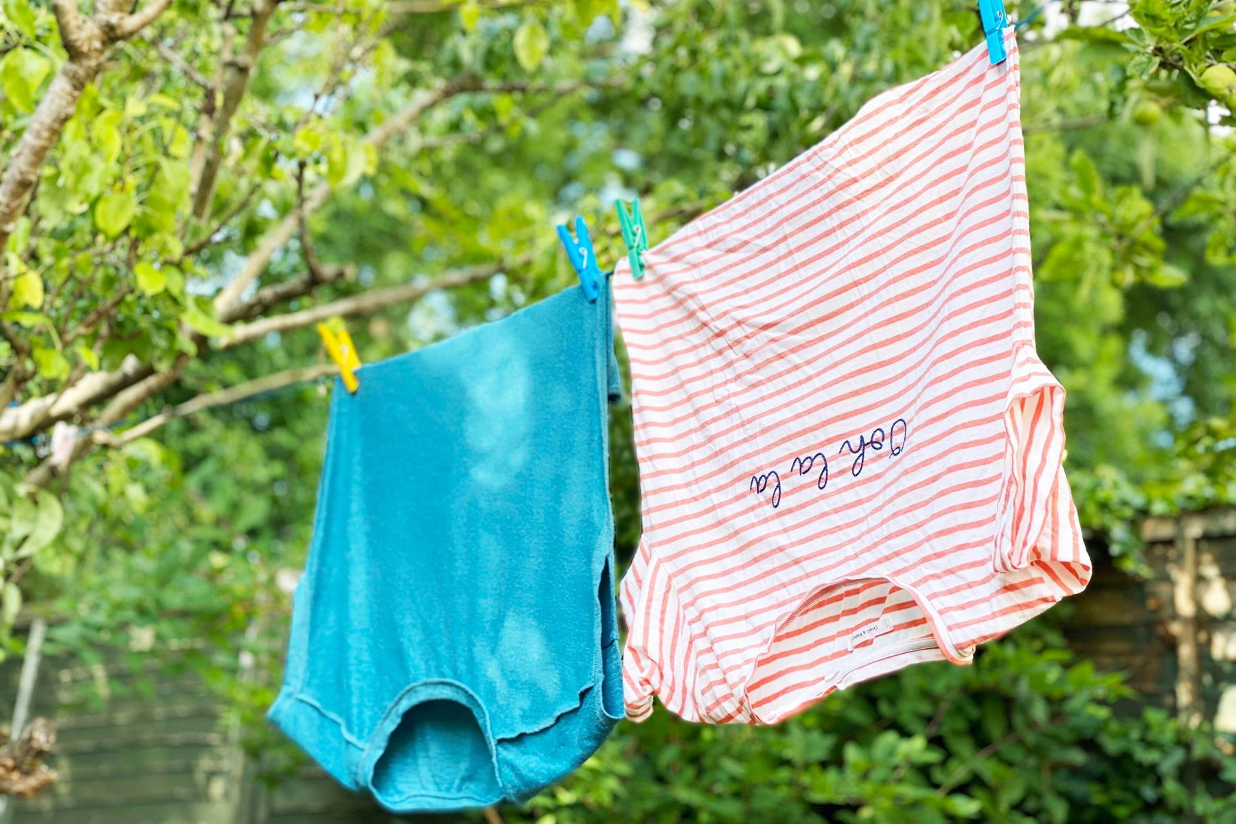 Tops on a washing line outside