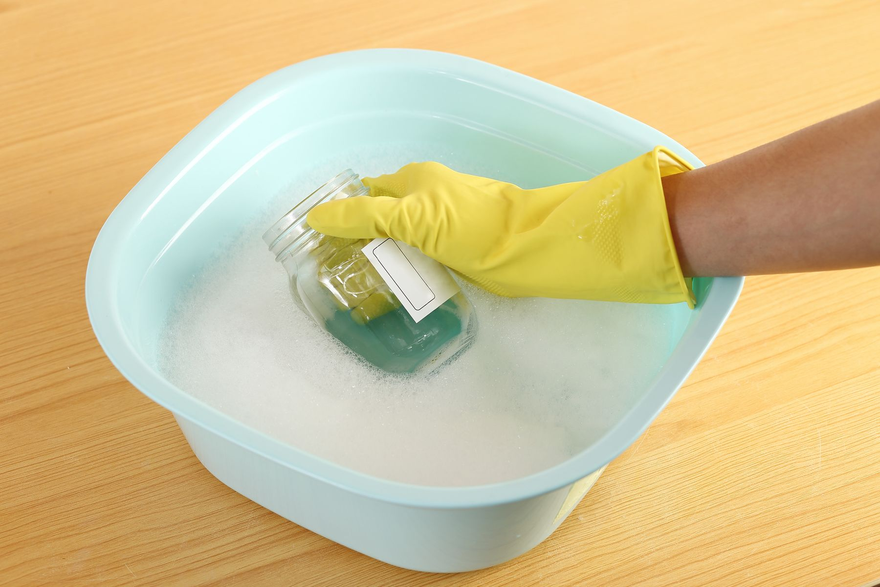 Step 1: Washing a label from a jar in hot soapy water